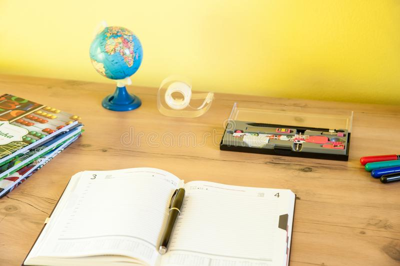 Desk with equipment for school and the calendar for better planning time. Back to school / desk with equipment for school and the calendar for better planning stock image