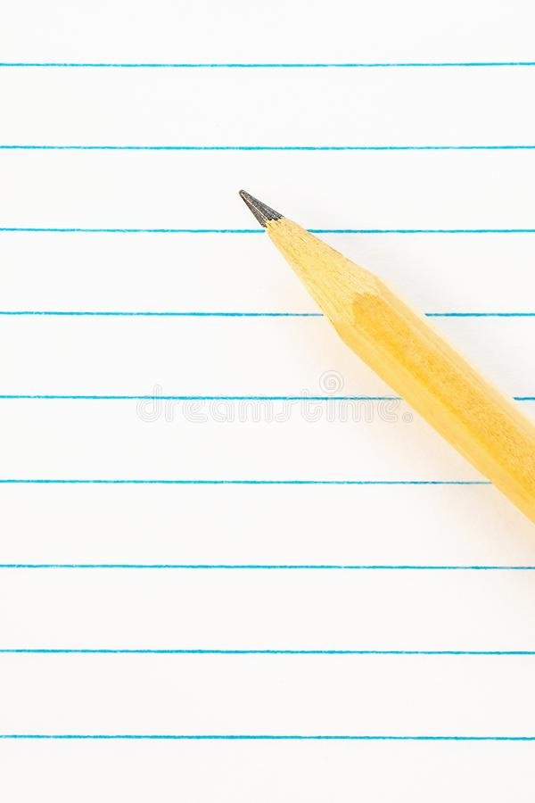 Back to school education concept - blank note paper with pencil, background close-up for the new academic year begin and study royalty free stock images