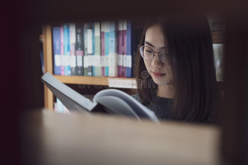 Back to school education knowledge college university concept, Beautiful female college student holding her books smiling happily. Standing in library, Learning stock photos
