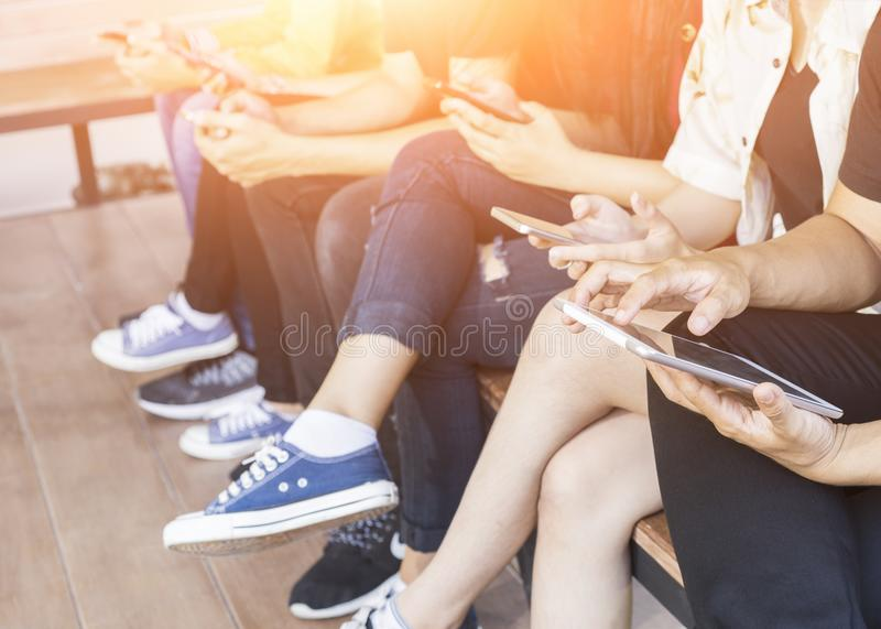 Back to school education knowledge college university concept, Students Education Social Media Laptop Tablet, Young people being u. Sed computer and tablet royalty free stock image