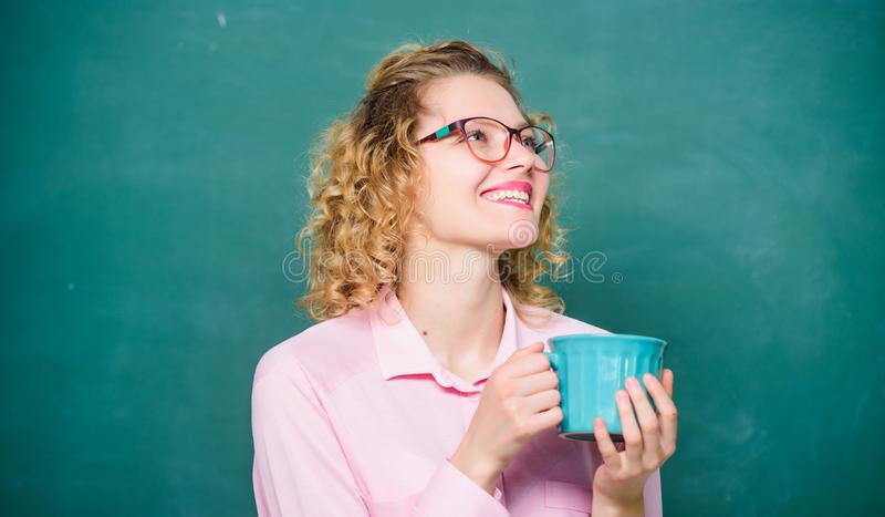 Back to school. Energy charge for whole day. Coffee addicted. Sip recharging body and mind. Dose of caffeine. Teacher. Eyeglasses drink coffee chalkboard stock image