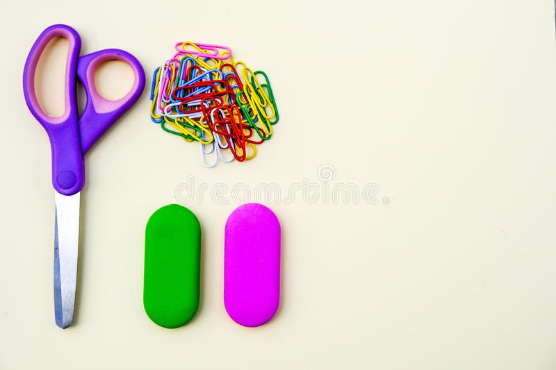 Back To School Equipment Scissors Rubbers and Paper Clips. With Copy Space royalty free stock photos