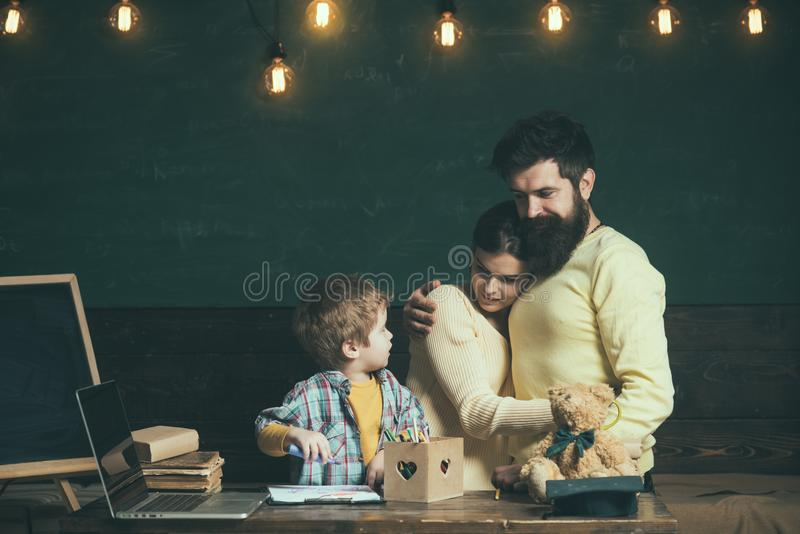 Back to school. Family back to school. Little child back to school. Boy and parent back to school. A family of learning.  royalty free stock image