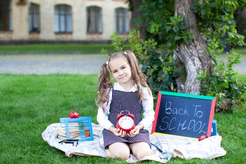 Back to school. first day of autumn. Little Girl retro alarm clock. School years. time to go to school. Child education, school co royalty free stock photos