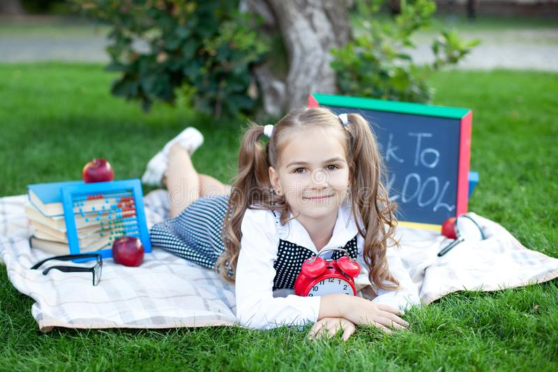 Back to school. first day of autumn. Little Girl and retro alarm clock. School years. time to go to school. Child education, schoo stock photo
