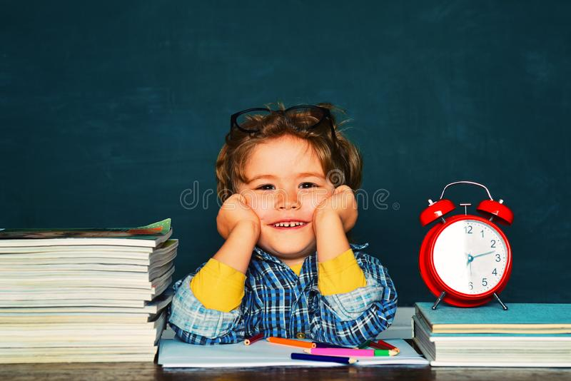 Back to school. Funny little boy pointing up on blackboard. Great study achievement. royalty free stock photo