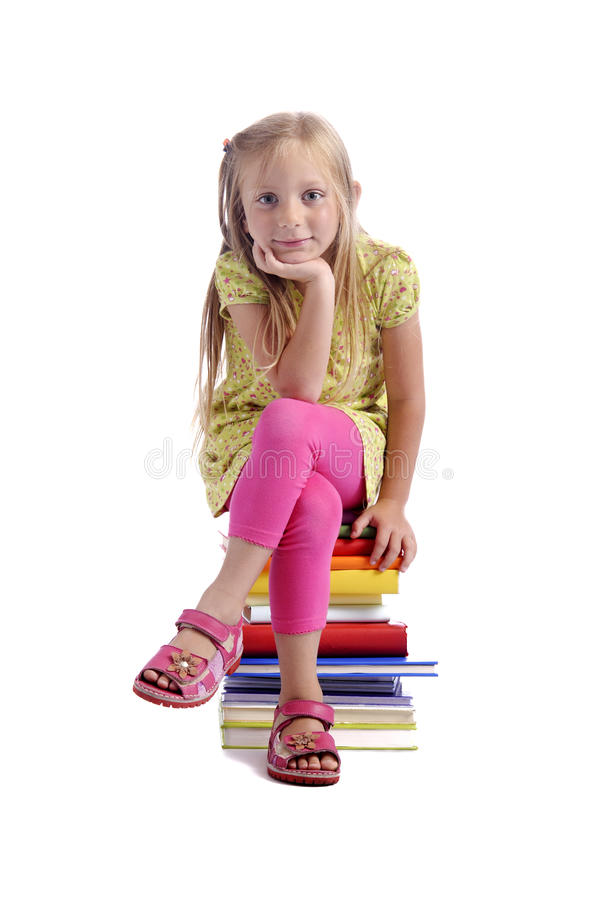 Download Back To School. Girl Sitting On A Stack Of Books Stock Photo - Image of sandal, legging: 20531912