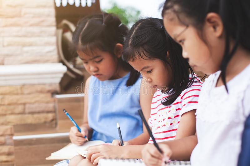 Group of asian children reading a book royalty free stock photo