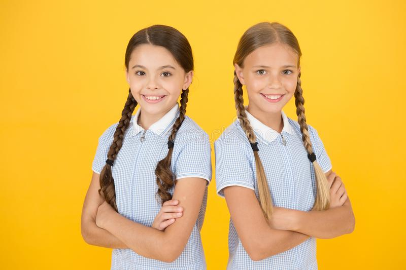 Back to school. happy beauty with pigtails. happy childhood. brunette and blond hair. sisterhood concept. best friends stock photos