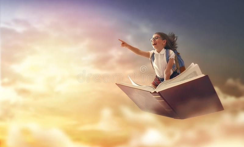 Child flying on the book royalty free stock image
