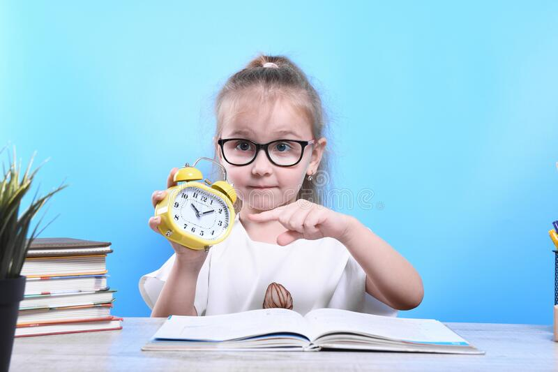 Back to school .Happy cute industrious child is sitting at a desk indoors. Kid is learning in class. Back to school Happy cute industrious child is sitting at a stock photo