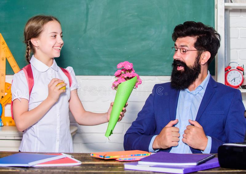 Back to school. Happy teachers day. knowledge day is 1 september. teachers day. Daugghter and father with flowers. Flower present for best teacher. small royalty free stock photography