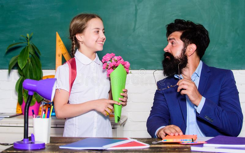 Back to school. Happy teachers day. teachers day. Daugghter and father with flowers. flower present for best teacher royalty free stock photography