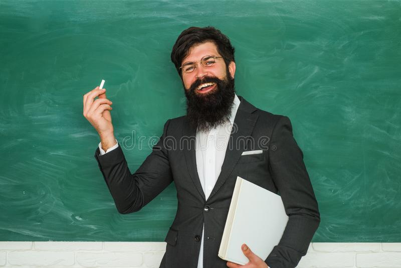 Back to school and happy time. Academic success is much more about hard work than inborn talent. Professor in class on stock image