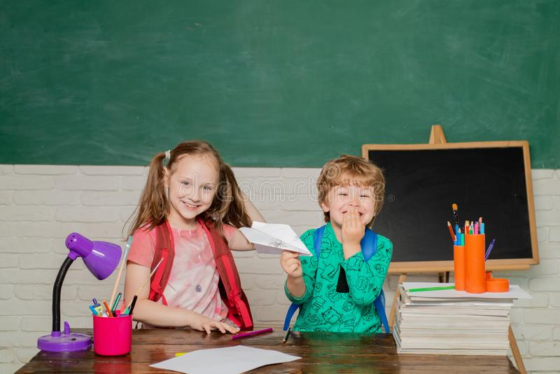 Back to school and happy time. Cute little preschool kid boy with Little child girl in a classroom. Concept of education stock image