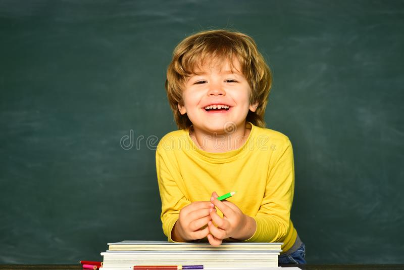 Back to school and happy time. Schoolkid or preschooler learn. Concept of education and reading. Kids school. Back to school and happy time. Schoolkid or stock images