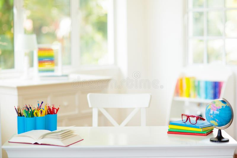 Back to school. Kids desk with books, globe royalty free stock photography