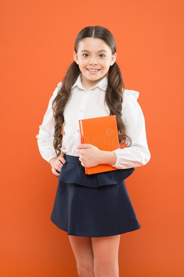 Back to school. Knowledge day. Possible everything. Schoolgirl enjoy study. Kid school uniform hold workbook. School. Lesson. Child doing homework. Believe in stock photography