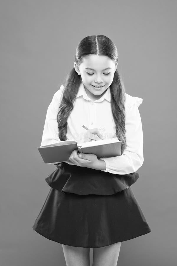 Back to school. Knowledge day. Schoolgirl enjoy study. Kid school uniform hold workbook. School lesson. Child doing. Homework. Your career path begins here stock image