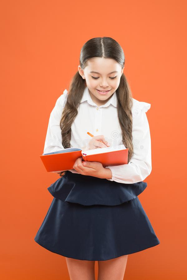 Back to school. Knowledge day. Schoolgirl enjoy study. Kid school uniform hold workbook. School lesson. Child doing. Homework. Your career path begins here royalty free stock photo