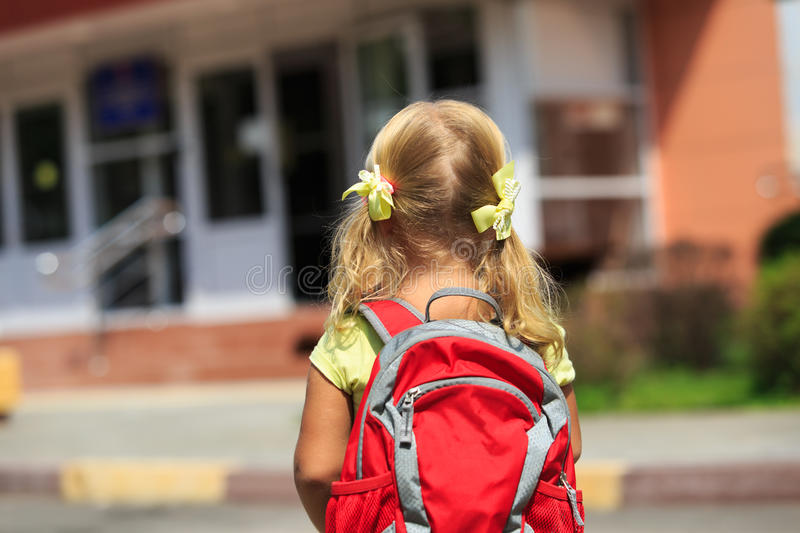 Back to school - little girl near preschool or daycare. Back to school - little girl with backpack going to school or daycare royalty free stock photography