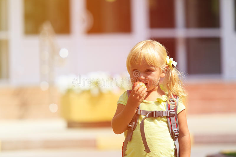 Back to school - little girl at preschool or daycare stock images