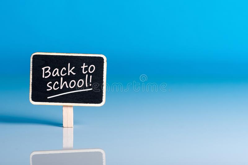 Back to school - Message at little plate at blue background. Education concept, 1 september time stock images
