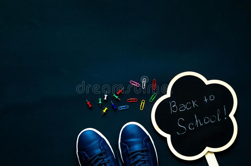 Back to school over chalkboard background. School supplies on black background. Close-up, copy space stock photography