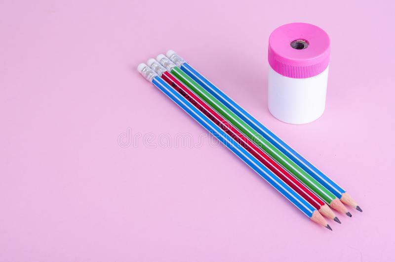 Back to school. Pencils, pencil sharpener on bright pink background. Place for text. Studio Photo stock photography