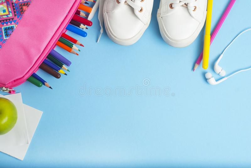 Back to school, pink case, lunch sandwich apple, colorful pencils and blue background with copy space. Back to school, pink case, lunch sandwich apple, colorful stock image