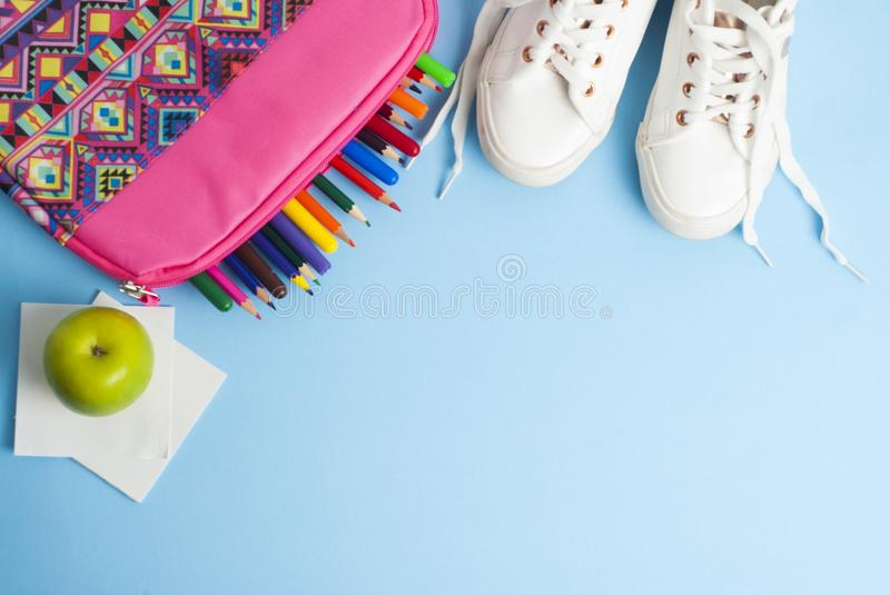 Back to school, pink case, lunch sandwich apple, colorful pencils and blue background with copy space. Back to school, pink case, lunch sandwich apple, colorful royalty free stock image