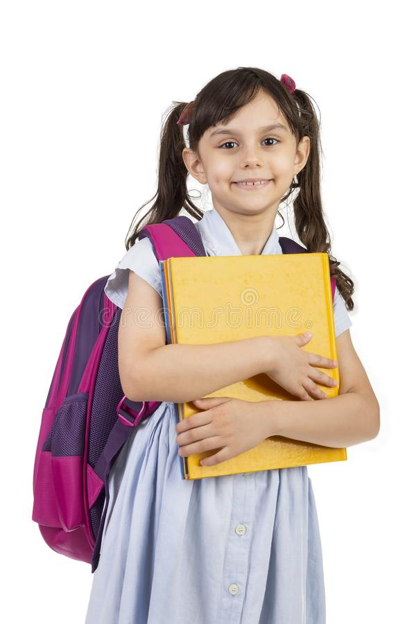 Back to school - Portrait of school girl child holding a book royalty free stock images