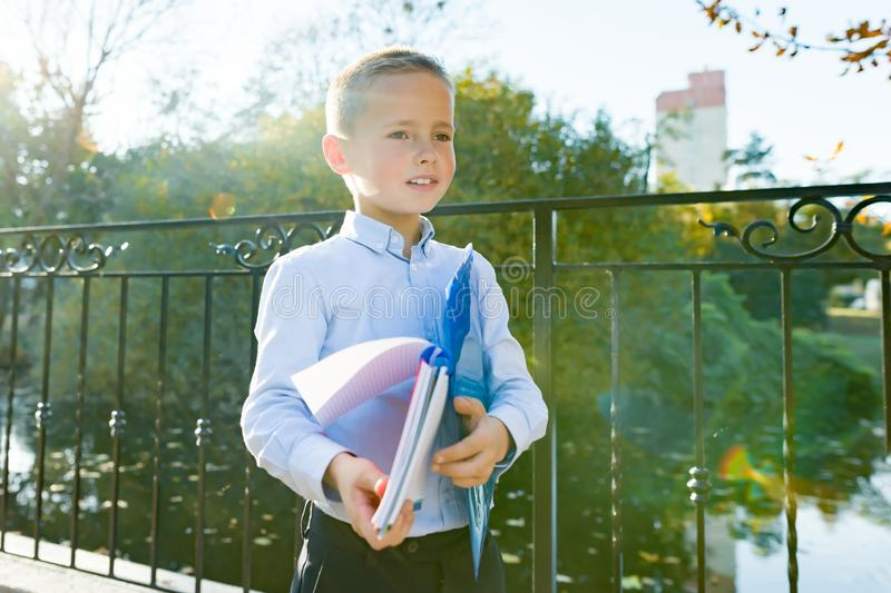 Back to school, portrait of boy with backpack, school supplies royalty free stock photo