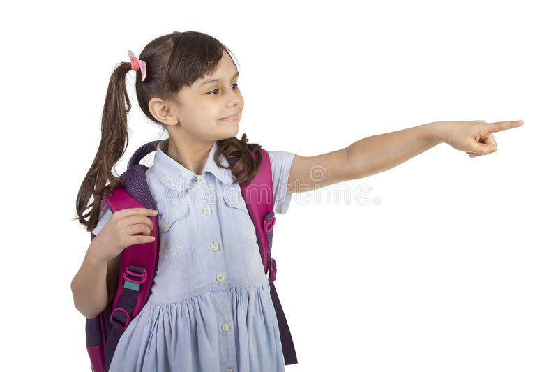 Back to school - Portrait of school girl child smiling and pointing with her finger royalty free stock images