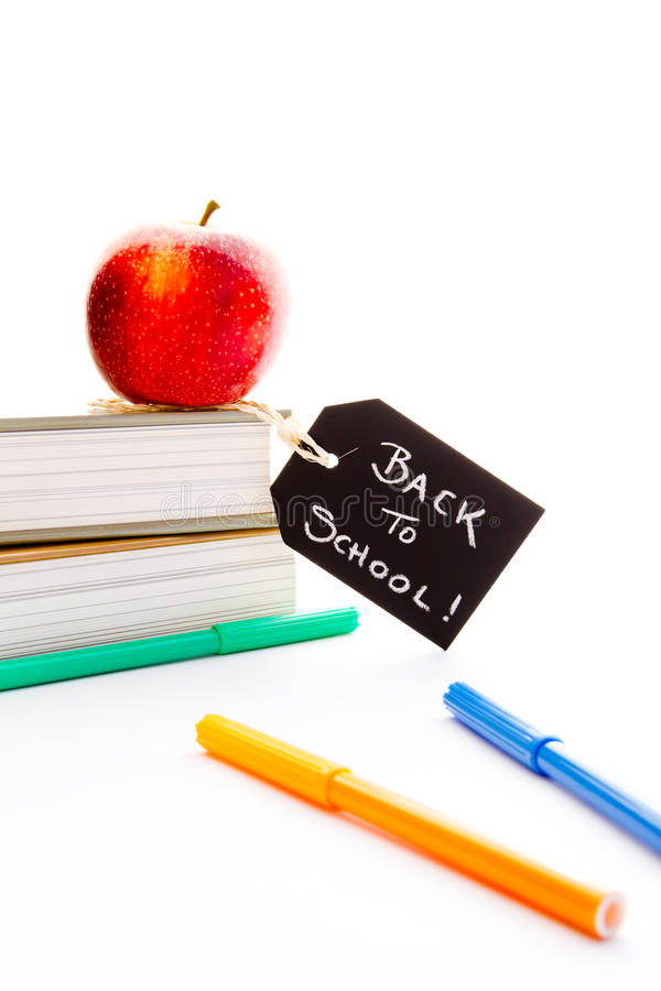 Back to School - Red Apple, books and pens. With blackboard handwritten chalk label stock photo