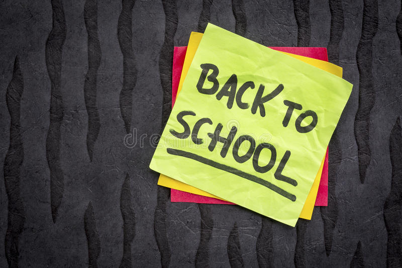 Back to school reminder note royalty free stock photo