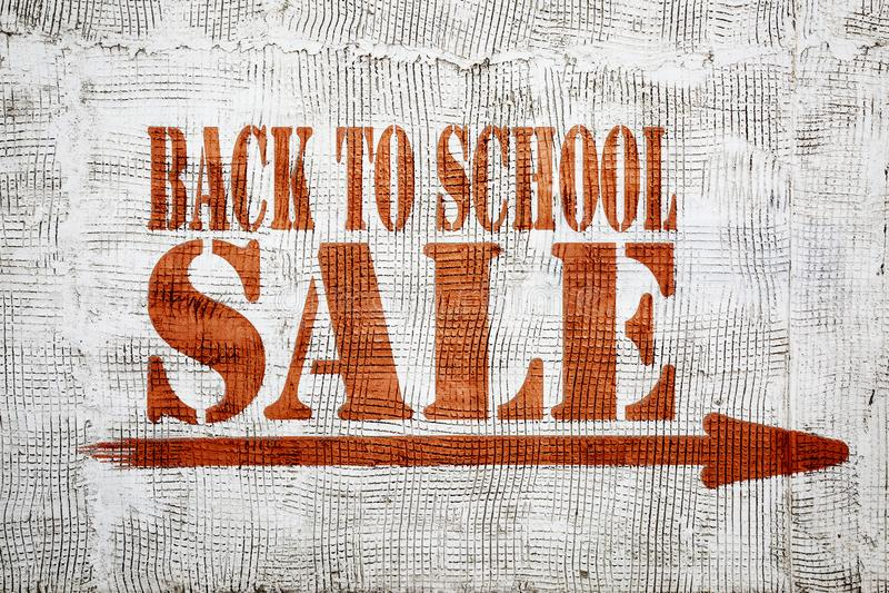 Back to school sale graffiti on stucco wall royalty free stock image