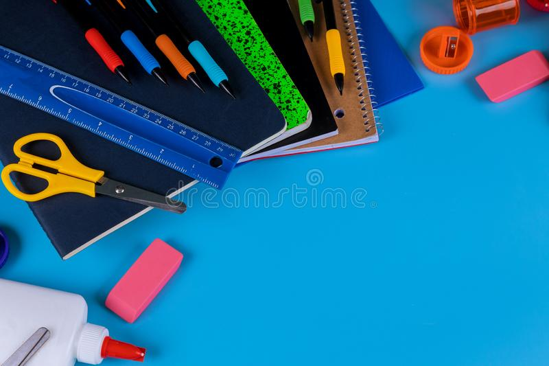 Back to school. School supplies on blue background. Back to school stuff. School supplies on blue background, education, pencil, scissors, accessories, ruler stock images