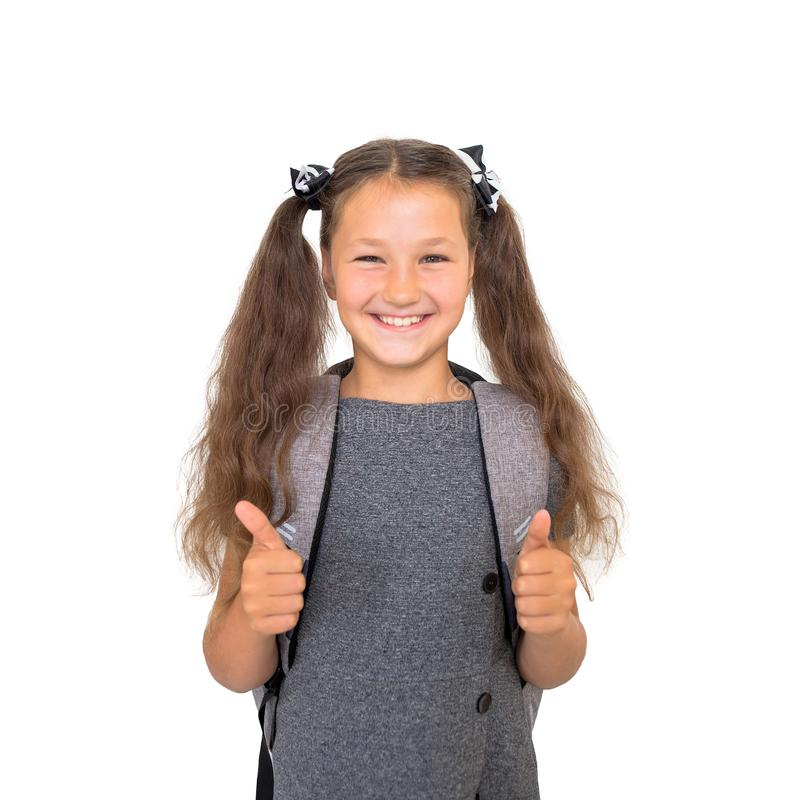 Back to school! Schoolchild shows thumbs up. royalty free stock image