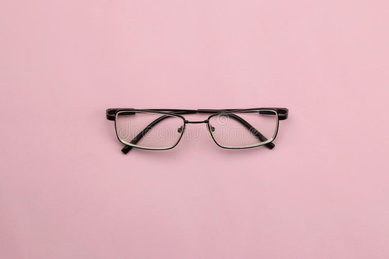 Back to school. stationery, school supplies, glasses on a bright pink background. top view. minimalism concept stock photo