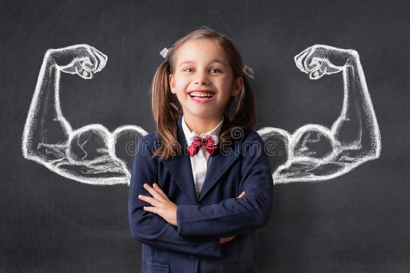 Back To School and Strong Student Concept, Portrait of Happy Smiling Child royalty free stock images