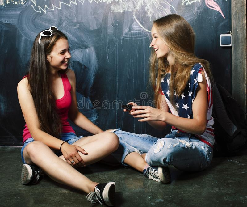 Back to school after summer vacations, two teen real girls in cl royalty free stock images