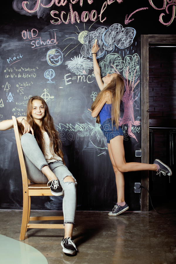 Back to school after summer vacations, two teen royalty free stock image