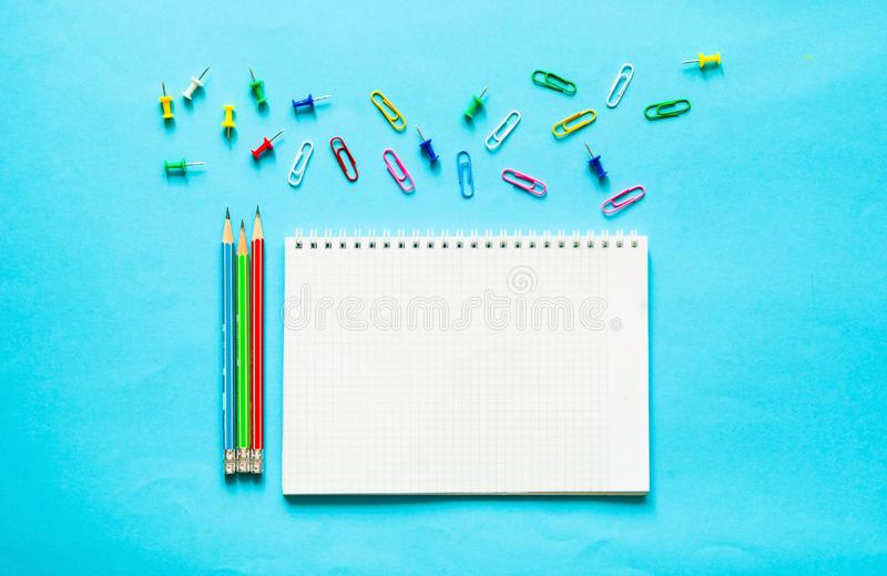 Back to school. School supplies on blue background. Back to school over chalkboard background. School supplies on blue background.Close-up, copy space royalty free stock image