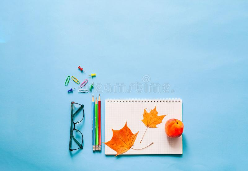 Back to school. School supplies on blue background. Close-up, copy space stock photography