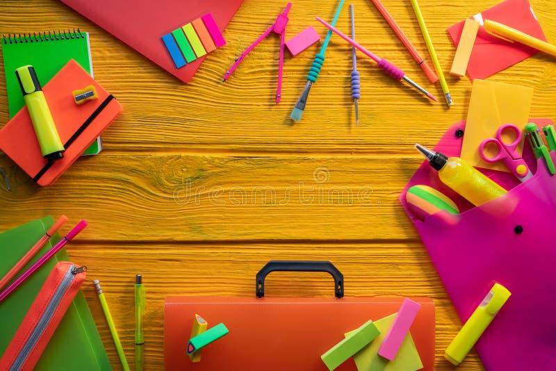 Back to school supplies vivid arrangement. Back to school supplies arrangement vivid colorful neon color in yellow background desk stock image