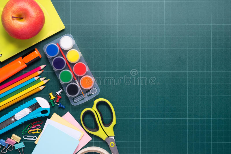 Back to school and supplies on wood. Back to school and supplies on chalkboard background stock photography