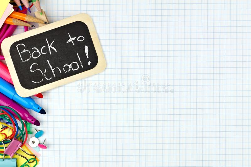 Back to School tag with school supplies on graphing paper royalty free stock photos