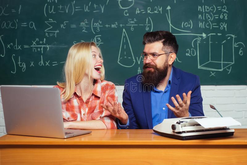 Back to school. Teachers day. Male home tutor helping girl with studies. Studying at university. Student Studying Hard royalty free stock photography
