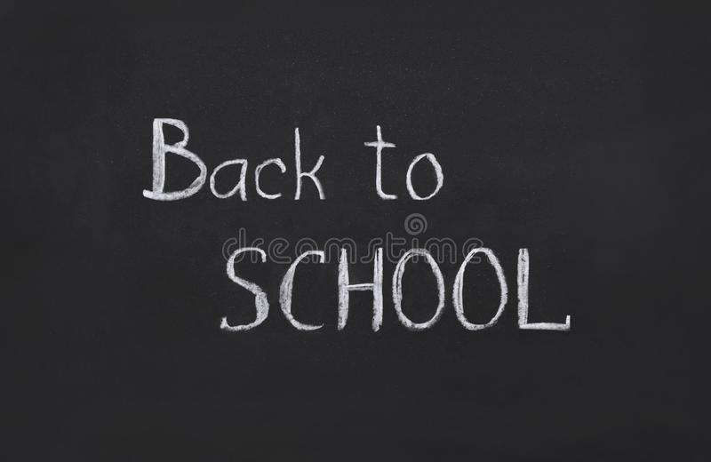 Back to school, template, handwritten in chalk, text on a black board, collage royalty free stock image